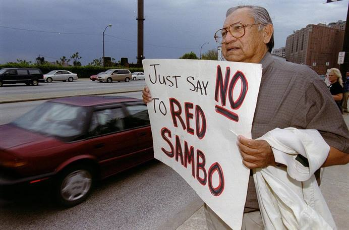 In this file photo, the Rev. Homer Noley, a United Methodist from Wilburton, Okla., joins other members of his denomination in protesting outside a May 11, 2000, Cleveland Indians baseball game held during The United Methodist General Conference. Rev. Noley died in 2018. Photo by Paul Jeffrey, UM News.