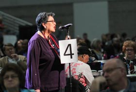 "Cynthia Kent, chairperson of the Native American International Caucus, speaks on a petition that asks The United Methodist Church ""to be intentional about raising awareness of the harm caused by some sports teams through the use of mascots and/or symbols promoting expressions of racism and disrespect of Native American people,"" during the May 19 plenary session of the 2016 General Conference in Portland, Ore. File photo by Maile Bradfield, UM News."