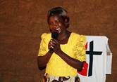 """The Rev. Rosemary Iseren, pastor of Dirakho United Methodist Church in Busia, Kenya, is preaching to her congregants in their homes and rural villages during the coronavirus pandemic. She dubbed the outreach """"D2D,"""" and other pastors in the region have followed her lead. Photo by Gad Maiga, UM News."""