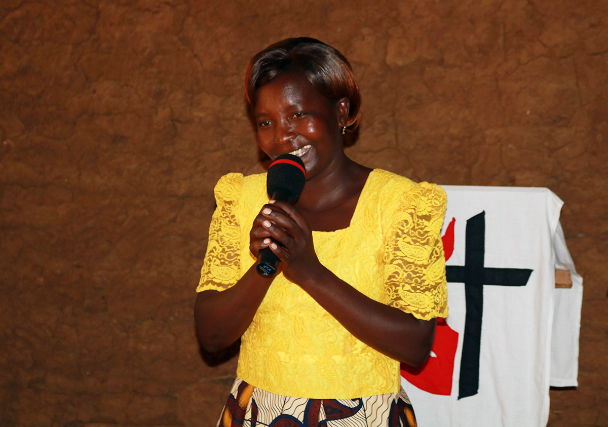 "The Rev. Rosemary Iseren, pastor of Dirakho United Methodist Church in Busia, Kenya, is preaching to her congregants in their homes and rural villages during the coronavirus pandemic. She dubbed the outreach ""D2D,"" and other pastors in the region have followed her lead. Photo by Gad Maiga, UM News."