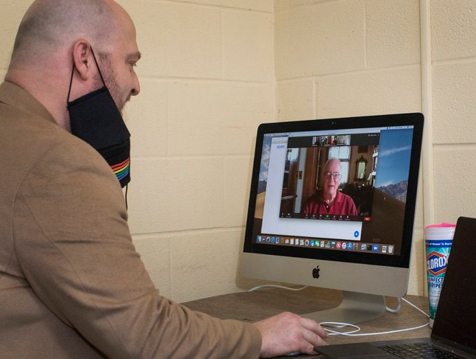 Joe Lee, music director at East End United Methodist Church in Nashville, Tenn., talks with COVID-19 survivor and choir member Carl Zehner, using ZOOM. Zehner nearly died from the virus and had a happy virtual reunion with Lee and choir members on July 12. Photo by Kathleen Barry, UM News.