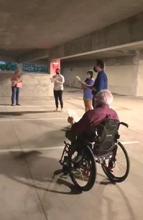 """Choir members from St. Luke's United Methodist Church in Houston perform an unaccompanied version of the tune """"Adoro te devote"""" (""""Humbly I adore Thee, Verity unseen"""") in a parking garage. Watch video. Video image courtesy of St. Luke's United Methodist Church by UM News."""