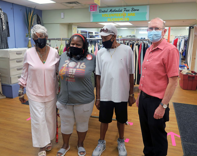 The Rev. John Edgar, executive director of Community Development for All People, in Columbus, Ohio, with three volunteers at the Free Store at the community center. Photo courtesy of Community Development for All People.