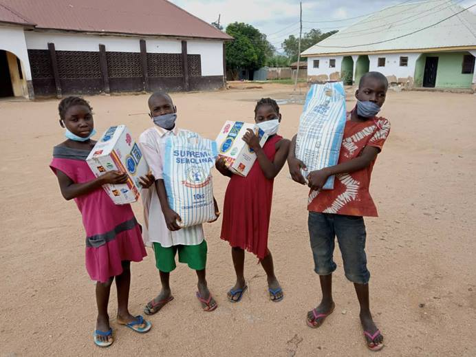 Children from The United Methodist Church's orphanage in Jalingo, Nigeria, hold some of the foodstuffs they received from Young Africa Leadership Development as part of its COVID-19 awareness campaign. Photo courtesy of Peter Cibuabua, Young Africa Leadership Development.