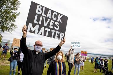 The Rev. Jeremy Wicks (front) takes part in a Black Lives Matter demonstration in northern Michigan. Wicks has served as a police chaplain, a reserve police officer and a Black Lives Matter organizer. Photo courtesy of the Rev. Jeremy Wicks.