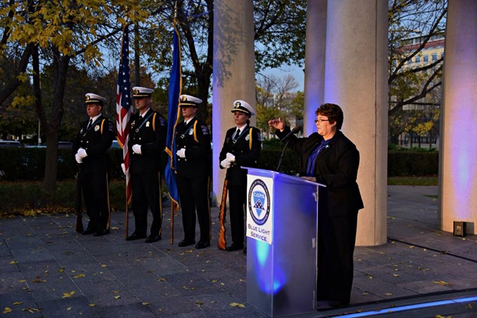The Rev. Dawn Houser speaks during the Blue Light Vigil in support of families of law enforcement officers killed in the line of duty in St. Paul, Minn. Houser is a police chaplain as well as pastor of Aitkin United Methodist Church in Aitkin, Minn. Photo courtesy of the Rev. Dawn Houser.