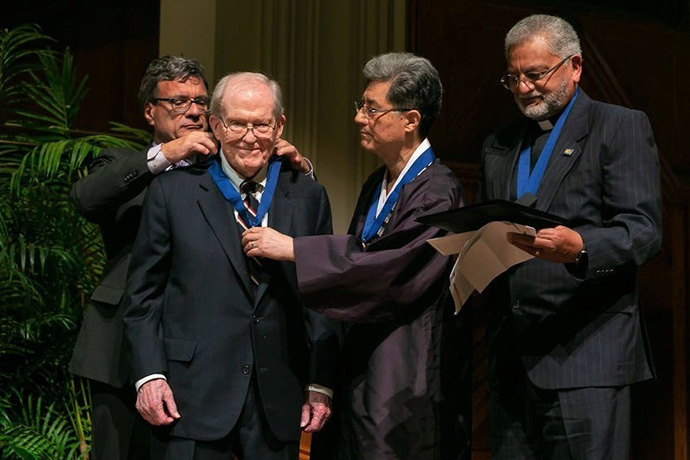 On November 21, 2019, at the 2019 World Methodist Peace Award Ceremony held at Grace United Methodist Church in Atlanta, Thomas Kemper, General Secretary of the Global Ministries (left) conferred the 2019 World Methodist Peace Award Medal to the Rev. James Laney. The Rev. Jong-Chun Park, president of the World Methodist Council and one of Laney's students, assists. Ivan Abrahams (right), General Secretary of the World Methodist Council stands by. Photo courtesy of Cindy Brown, Global Ministries.