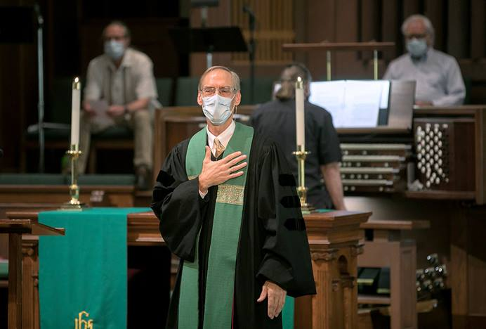 The Rev. Paul Escamilla takes to the pulpit at Lauren Heights United Methodist Church, in San Antonio, on June 14. The church reopened for in-person worship that Sunday but closed again the following Sunday and has remained closed because of high COVID-19 case numbers locally. Photo by David Smith, courtesy of Laurel Heights United Methodist Church.