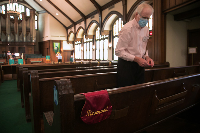 Steve Haney checks seating restrictions for the Sunday, June 14 worship service at Laurel Heights United Methodist Church, in San Antonio. Haney, who teaches at the UT Health San Antonio Dental School, serves on a COVID-19 team at the church that has come up with criteria and even a color-coded chart to guide decisions on opening and closing. Laurel Heights closed again for in-person worship the following Sunday and remains closed due to high COVID-19 case numbers in the area. Photo by David Smith, courtesy of Laurel Heights United Methodist Church.