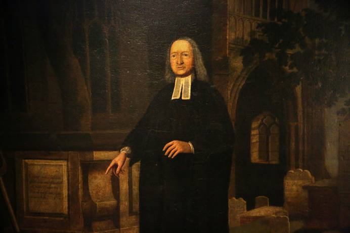A portrait of John Wesley standing in a graveyard is on display at the Museum of Methodism located beneath Wesley's Chapel in London. Photo by Kathleen Barry, United Methodist Communications.