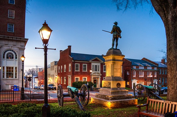 A statue of a Confederate soldier stands in Court Square, downtown Charlottesville, Va., — erected in 1909 and paid for by the county, the city and the United Daughters of the Confederacy. Photo by Bob Mical, Wikimedia Commons.