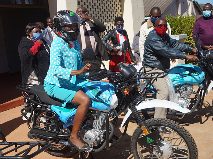 The Revs. Sandra Hakuna and Shepherd Nyakatsapa try out new motorbikes donated by church partners during a handover ceremony at Old Mutare United Methodist Church in Mutare, Zimbabwe. The pastors will use the bikes to conduct ministry in rural parts of the country. Photo by Kudzai Chingwe, UM News.