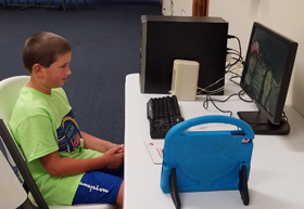 A student uses a computer at Robbinsville United Methodist Church in North Carolina. The church is providing Internet access to students. Photo by the Rev. Eric Reece.