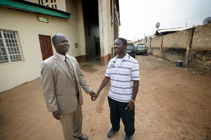 Dr. Martin Salia (right) visits with Bishop John K. Yambasu at the United Methodist Church's Kissy Hospital outside Freetown, Sierra Leone, in April 2014. The hospital was closed Nov. 11, 2014, after Salia, chief medical officer and surgeon, tested positive for Ebola. Salia died later that month of Ebola. File photo by Mike DuBose, UM News.