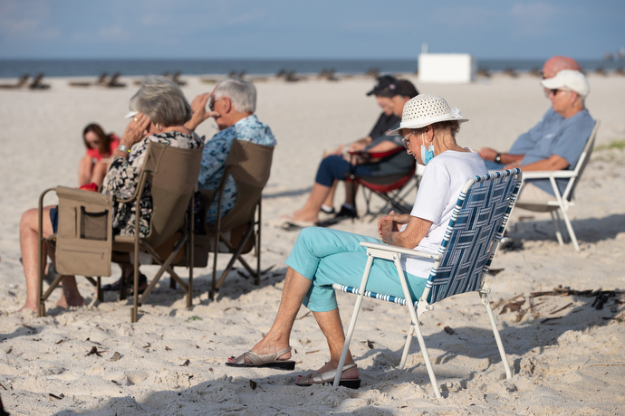 Marion Bethea (front) joins other worshippers in prayer during the Galilean Beach Service. She has regularly attended the outdoor service since 1994. Photo by Mike DuBose, UM News.