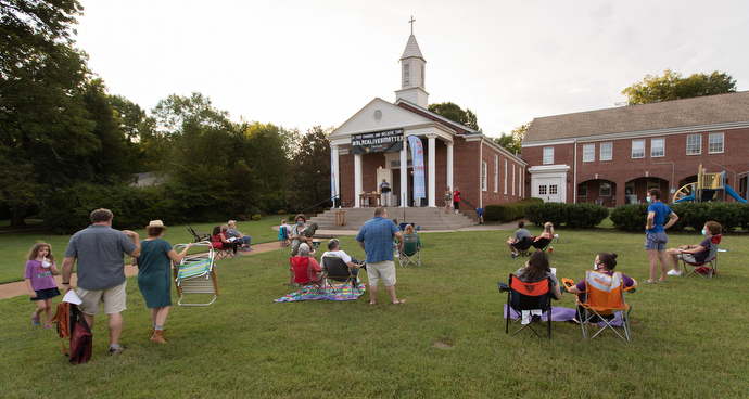 Parishioners gather on the lawn for an outdoor worship and communion service at Glendale United Methodist Church in Nashville, Tenn. Photo by Mike DuBose, UM News.