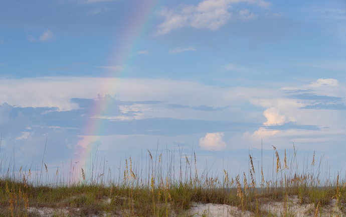 A rainbow arcs across the sky at Gulf State Park in Gulf Shores, Ala., just prior to the start of the Galilean Beach Service. Photo by Mike DuBose, UM News.