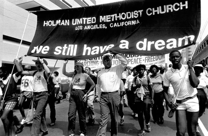 The Rev. James Lawson (center) helps lead the March for Peace, Jobs and Freedom in Washington in 1984. File photo by John C. Goodwin, Board of Global Ministries.