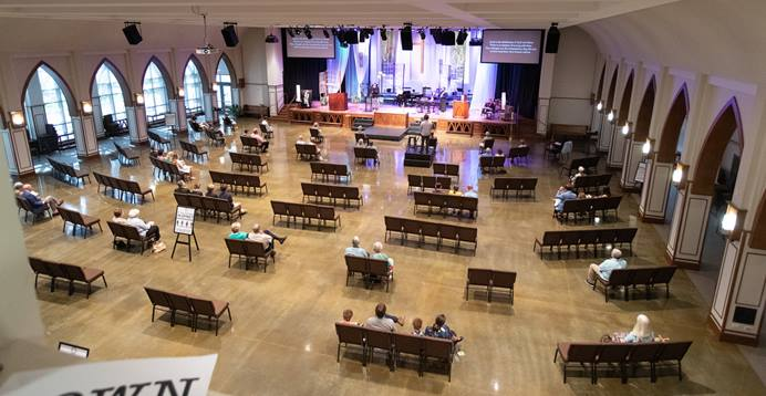 Parishioners sit apart from one another during worship at Franklin (Tenn.) First United Methodist Church. The church, which recently returned to in-person worship, has adopted safety protocols, including social distancing, to help prevent the spread of COVID-19. Photo by Mike DuBose, UM News.