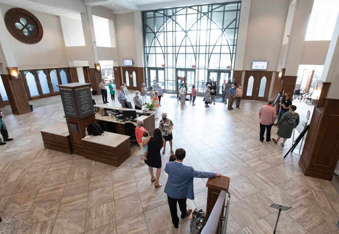 Parishioners gather in the Friendship Commons area to receive safety instructions before worship at Franklin First United Methodist Church. Photo by Mike DuBose, UM News.