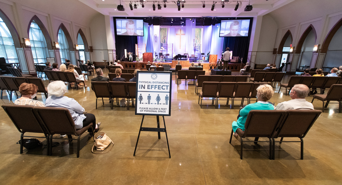 Parishioners sit apart from one another during worship at Franklin First United Methodist Church. Photo by Mike DuBose, UM News.