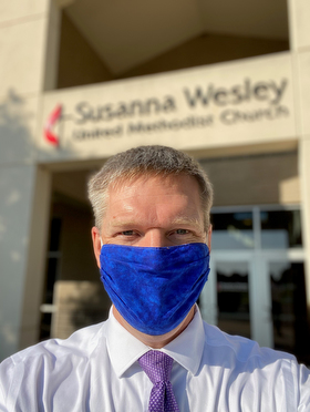 The Rev. Andrew Conard, pastor of Susanna Wesley United Methodist Church in Topeka, Kan., dons a mask for the protection of himself and congregants during worship services. The church resumed worshipping in-person on July 19. Photo courtesy of the Rev. Andrew Conard.
