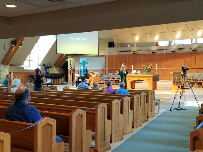 The Rev. Amy Lippoldt leads worship at St. Paul's United Methodist Church Papillion in Nebraska. About 35 people attended the first services back in the sanctuary on Aug. 16. Photo by the Rev. Rebecca Hjelle.