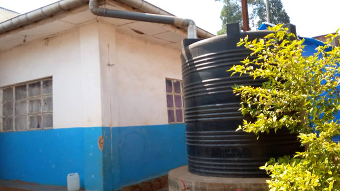 """A new water tank holds water reserves at United Methodist Irambo Hospital in Bukavu, Congo. The tank was installed to collect rainwater to use at the health center. """"(The tanks) sometimes allow us to conserve water, especially during this dry season when water has become a scarce commodity in the city of Bukavu,"""" said Dr. Djimmy Kasongo, medical director at the hospital. Photo courtesy of United Methodist Irambo Hospital."""