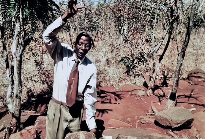 Centenarian Joel Makombe spends time at his prayer shrine in Murewa, Zimbabwe. At 112, Makombe has been a United Methodist for more than 85 years. He is a founding member of Corner Store United Methodist Church in the Murewa Uzumba-Maramba-Pfungwe District. Photo by the Rev. Taurai Emmanel Maforo, UM News.
