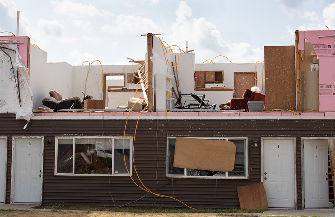 An apartment building stands with its roof open to the sky and top floor walls ripped away following an Aug. 10 derecho in Cedar Rapids, Iowa. Photo by Mike DuBose, UM News.