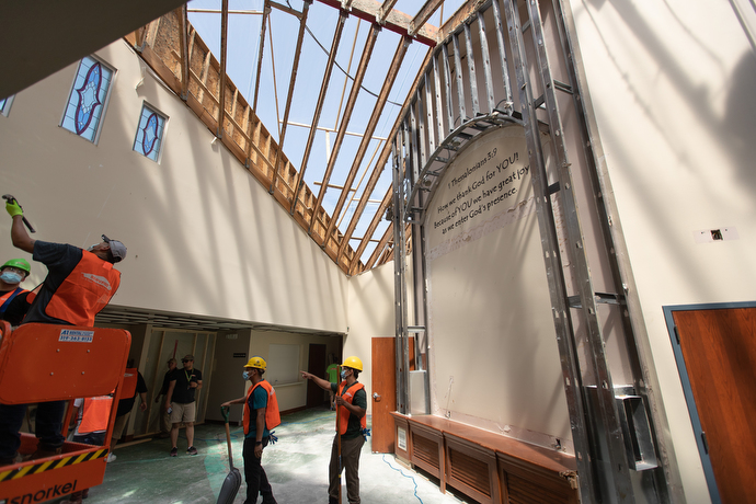 A cleanup crew works in the narthex of Christ Community Church in Marion, Iowa. The United Methodist church had part of its roof torn away in an Aug. 10 derecho. Photo by Mike DuBose, UM News.