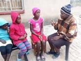 Perpetual Makadzange talks to her three children, (from left) 6-year-old Tizzelyn, 7-year-old Tanatswa and 12-year-old Tsepang, at their home in Zimunya, Zimbabwe. The United Methodist schools that the children attend remain closed to stop the spread of the coronavirus. Photo by Kudzai Chingwe, UM News .