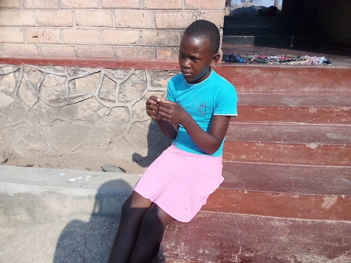 """Tsepang Makadzange, 12, hopes to return to school soon. She attends United Methodist Mutambara Central Primary School in Chimanimani, Zimbabwe. """"At school, we are occupied and protected, but COVID-19 has destroyed all this,"""" she said."""