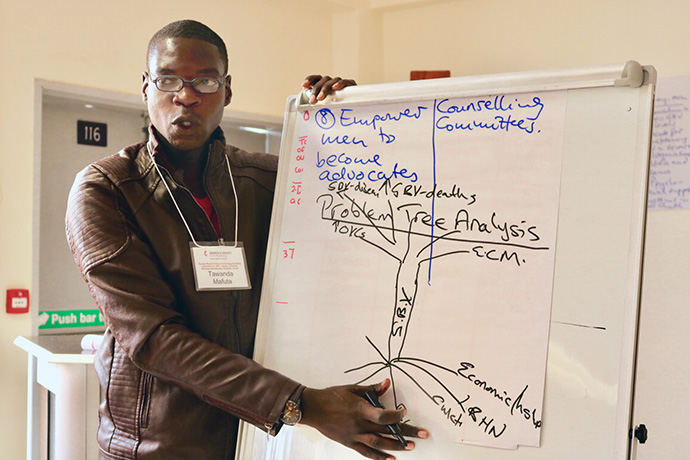 Tawanda Mafuta, a youth member from the Chitungwiza Marondera District, makes a presentation during a gender-based violence awareness workshop hosted by the United Methodist Board of Church and Society for the Zimbabwe Episcopal Area. File photo courtesy of the United Methodist Board of Church and Society.