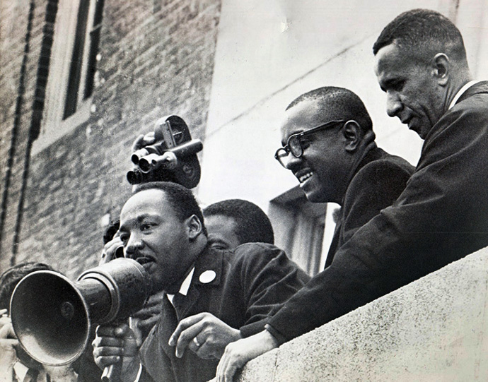 The Rev. Gil Caldwell (right) stands with the Revs. Martin Luther King Jr. (left) and Virgil Wood on the roof of a Boston public school in 1965. Photo courtesy of the Rev. Gilbert H. Caldwell.