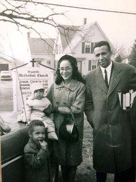 The Rev. Gil Caldwell stands outside of Bryantville United Methodist Church in Pembroke, Mass., with his wife, Grace Caldwell, and two sons in this undated photo. Caldwell served as senior pastor of five predominantly African American churches and four mostly white churches over six decades. Photo courtesy of UMC.org.