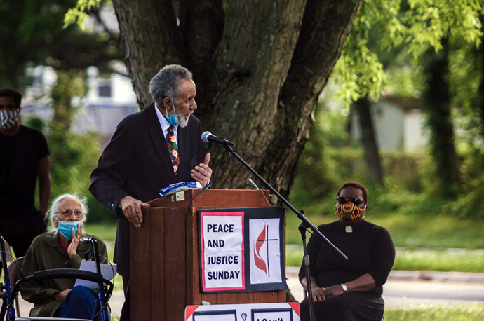 The Rev. Gil Caldwell stands up for Black Lives Matter at a peaceful rally, just months before he died. To Caldwell's right is his wife of more than 60 years, Grace Caldwell. To Caldwell's left is the Rev. Vanessa Wilson, chairperson of the Greater New Jersey Commission on Race and Religion and pastor of Good Shepherd United Methodist Church in Willingboro, N.J. File photo by Aaron Wilson Watson.