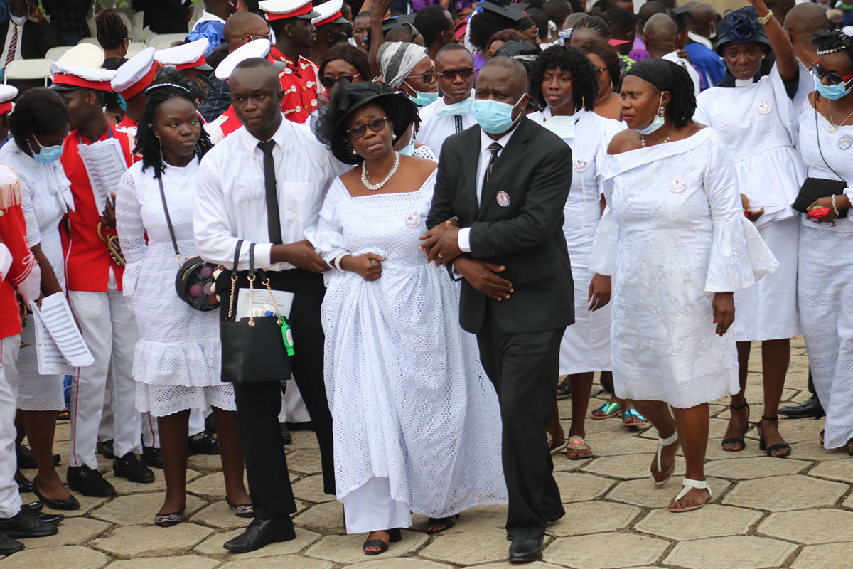 Family and friends of Bishop John K. Yambasu, (from left front) Elizabeth Yambasu, Emmanuel Yambasu, widow Millicent Yambasu and Alfred Lansana, arrive at the burial site on the campus of United Methodist University in Freetown, Sierra Leone. Photo by E Julu Swen, UM News.