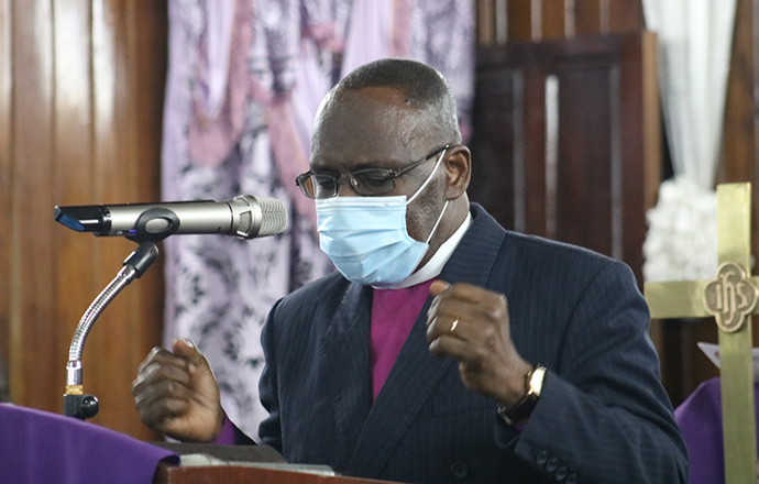 Bishop Benjamen Boni, Côte d'Ivoire, leads a moment of prayer during the Sept. 5 funeral vigil for Sierra Leone Area Bishop John K. Yambasu held at King Memorial United Methodist Church in Freetown, Sierra Leone.  Photo by E Julu Swen, UM News.