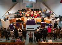 The Rev. Sheila Peters from Braden Memorial United Methodist Church preaches March 7, 2020, at a joint Sunday service held at Gordon Memorial United Methodist Church in Nashville, Tenn. Praying over attendees on the floor is the Rev. Paula B. Smith, pastor at Gordon Memorial. Strengthening The Black Church for the 21st Century works with predominately Black churches like Braden and Gordon on effective mission and ministry. Photo by Kathleen Barry, UM News.