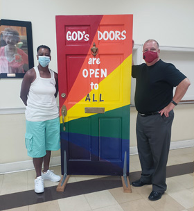 "A painted door displayed at Asbury Memorial Church in Savannah, Ga., proclaims, ""God's doors are open to all."" Photo courtesy of Asbury Memorial Church."
