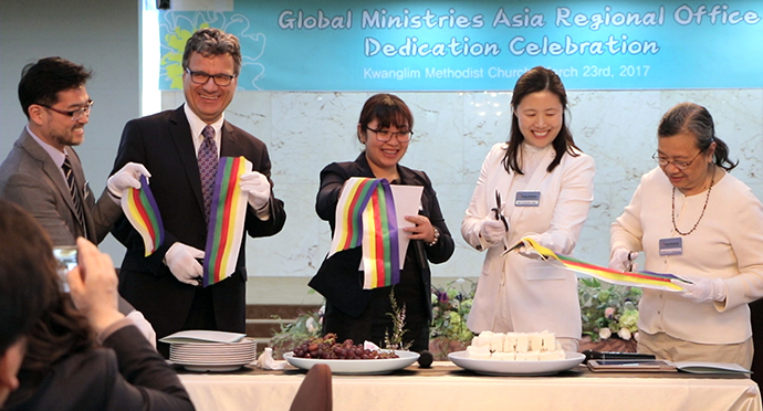 The Rev. Paul Kong, Thomas Kemper, Joy Eva Bohol, the Rev. Myungim Kim and Rebecca Asedillo cut the ribbon signifying the opening of the Asia Regional Office in Seoul, South Korea, in March 2017. File photo by Jennifer Silver, Global Ministries.