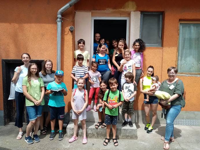 Children from the United Methodist congregation in Debrecen, Hungary, gathered for vacation Bible school in a new building recently bought by the church council. Photo courtesy of the Rev. László Khaled.