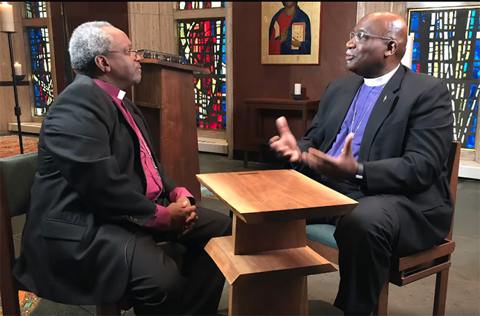 United Methodist Bishop Gregory Palmer (right) and The Episcopal Church's presiding bishop, Michael Curry, discuss full communion between the two denominations in 2019. The proposed agreement is on hold for now because of disruptions related to COVID-19. File screenshot from video courtesy of the Council of Bishops of The United Methodist Church.