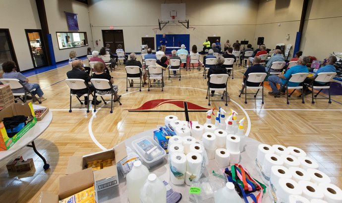 Parishioners gather for worship amid relief supplies in the gymnasium at Moss Bluff United Methodist Church in Lake Charles, La., following Hurricane Laura. Photo by Mike DuBose, UM News.