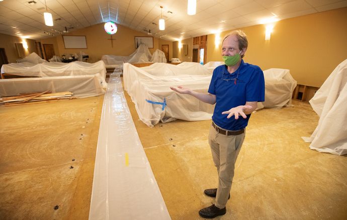 The Rev. Mark Bray describes the damage caused by Hurricane Laura at Moss Bluff United Methodist Church in Lake Charles, La. Photo by Mike DuBose, UM News.