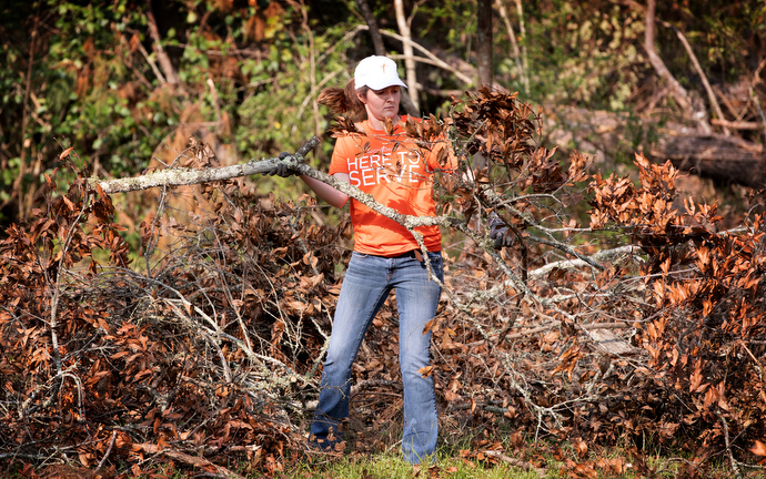 Volunteer Lauren Baxter helps clean up storm debris left by Hurricane Laura in DeRidder, La. Baxter is from Mid City Church, a campus of First United Methodist Church in Baton Rouge, La. Photo by Mike DuBose, UM News.