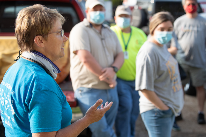 The Rev. Laraine Waughtal briefs volunteers as they prepare to clean up debris left by Hurricane Laura in DeRidder, La. Waughtal is pastor of First United Methodist Church in DeRidder and a former disaster response coordinator. Photo by Mike DuBose, UM News.