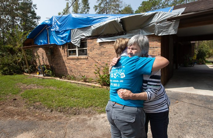 Mary Alice Wisdom (right) hugs her pastor, the Rev. Laraine Waughtal, during a visit to Wisdom's home in DeRidder, La., following Hurricane Laura. The hurricane damaged her roof and knocked out electricity. Photo by Mike DuBose, UM News.