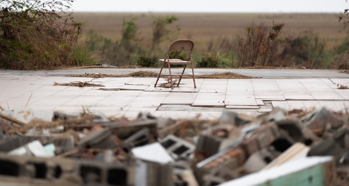 A solitary folding chair rests on the bare concrete slab that was home to Grand Chenier (La.) United Methodist Church before Hurricane Laura destroyed the building. Photo by Mike DuBose, UM News.
